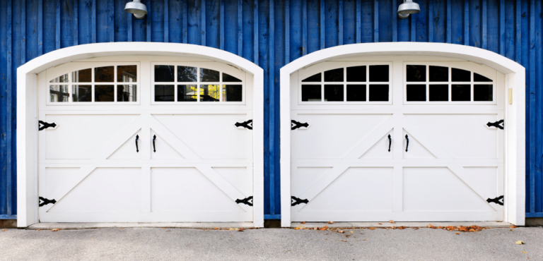 Blue house with white Carraige garage doors